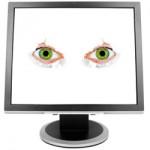 Eyes spying thorugh a computer